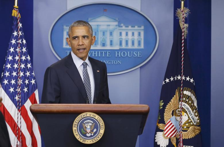U.S.  President Obama arrives to address a news conference at the White House in Washington