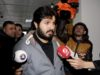 """FILE-In this Tuesday, Dec. 17, 2013 file photo, Turkish-Iranian businessman Reza Zarrab, who is charged currently in the U.S. for evading sanctions on Iran, is surrounded by the media members as he arrives at a courthouse in Istanbul,in a separate case against him. Turkey's Deputy Prime Minister Bekir Bozdag on Monday, Nov. 20, 2017 depicted an upcoming trial in the United States against Zarrab, the main defendant, as a """"conspiracy"""" against Turkey and also described him AS a """"hostage"""" who he claimed was being forced to testify against Turkey's government. Trial begins in New York on Nov. 27. (Depo Photos via AP, File)"""
