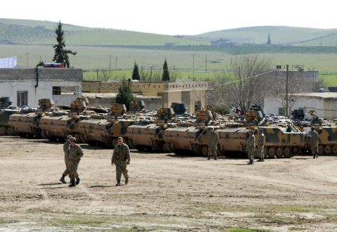 Turkish military armored vehicles, which took part in an operation inside Syria, are pictured near the Mursitpinar border crossing in the southeastern town of Suruc, Sanliurfa province, February 23, 2015. A Turkish military operation to rescue 38 soldiers guarding a tomb in Syria surrounded by Islamic State militants was launched to counter a possible attack on them, presidential spokesman Ibrahim Kalin said on Monday. The action, which involved tanks, drones and reconnaissance planes as well as several hundred ground troops, was the first of its kind by Turkish troops into Syria since the start of the civil war there nearly four years ago. REUTERS/Stringer (TURKEY - Tags: POLITICS CONFLICT MILITARY)